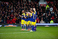 Sunday 05 January 2014<br /> Pictured: Swansea City Squad duing a minuties applause <br /> Re: Manchester Utd FC v Swansea City FA cup third round match at Old Trafford, Manchester