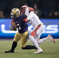 Andre Baccellia somehow holds onto the ball on 4th down to keep Washington's late game-tying drive alive.