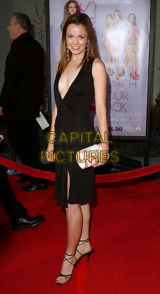 RACHEL BOSTON.Attending the world premiere of Mean Girls at the Cinerama Dome, Hollywood, California..April 19th 2004.smiling little black dress plunging neckline strappy heels red and white clutch bag full length full-length.*UK sales only*.www.capitalpictures.com.sales@capitalpictures.com.©Capital Pictures