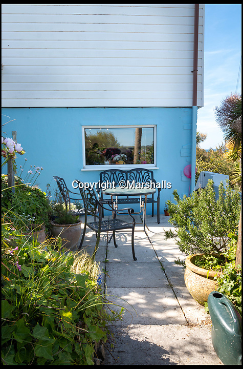 BNPS.co.uk (01202 558833)<br /> Pic:   Marshalls/BNPS<br /> <br /> The idyllic seaside home and art studio of a British painter famed for his vivid scenes of Cornish beaches has gone on the market for £1.7m.<br /> <br /> Prints of John Miller's iconic paintings of white sandy beaches, azure seas and cloudless blue skies proved extremely popular with homeowners in the 1990s and 2000s.<br /> <br /> Musician Chris Rea also used one of his seascape paintings for the front cover of his 2000 album King of the Beach.<br /> <br /> Miller's work was inspired by the very location where he lived - right next to the sea at Lelant, near St Ives, Cornwall.<br /> <br /> The property is divided into two houses that are used as holiday lets.