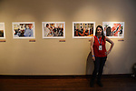 National Geographic Young Explorer Amanda Rivkin stands in front of her photographs documenting postwar Bosnia's reconstruction on exhibit at the Aa Haa West Gallery during the Mountainfilm Festival in Telluride, Colorado on May 22, 2015.