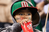 16 March 2009: A young fan of Team Mexico drinks a soda watching the game during the 2009 World Baseball Classic Pool 1 game 3 at Petco Park in San Diego, California, USA. Cuba wins 7-4 over Mexico.
