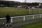 The home team defending a free-kick during the second-half as Gala Fairydean Rovers (in red) host Gretna 2008 in a Scottish Lowland League match at Netherdale, Galashiels. The home club were established in 2013 through a merger of Gala Fairydean, one of Scotland's most successful non-League clubs, and local amateur club Gala Rovers. The visitors were a 'phoenix' club set up in the wake of the collapse of the original club, which had competed for a short time in the 2000s before going bankrupt. The home aside won this encounter 4-1 watched by a crowd of 120 at a stadium which features one of the country's most notable stands, a listed building constructed in 1964 but at the time of this fixture closed to spectators on safety grounds.