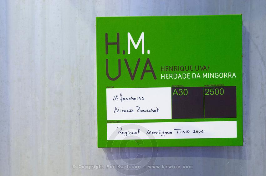 Fermentation tanks. Sign saying Alfrocheiro and Alicante Bouschet grapes. Henrque HM Uva, Herdade da Mingorra, Alentejo, Portugal