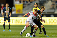 Jared Jeffrey (25) of D. C. United and Brian Carroll (7) of the Philadelphia Union. The Philadelphia Union defeated D. C. United 2-0 during a Major League Soccer (MLS) match at PPL Park in Chester, PA, on August 10, 2013.