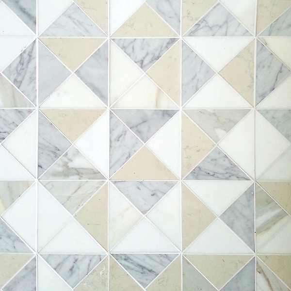 Christopher 2, a hand-cut stone mosaic, shown in honed Carrara, Calacatta, Thassos, and Bianco Antico, is part of the Illusions™ Collection by Sara Baldwin for New Ravenna.