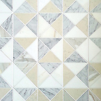 Christopher 2, a hand-cut stone mosaic, shown in honed Carrara, Calacatta, Thassos, and Bianco Antico, is part of the Illusions™ Collection by New Ravenna.