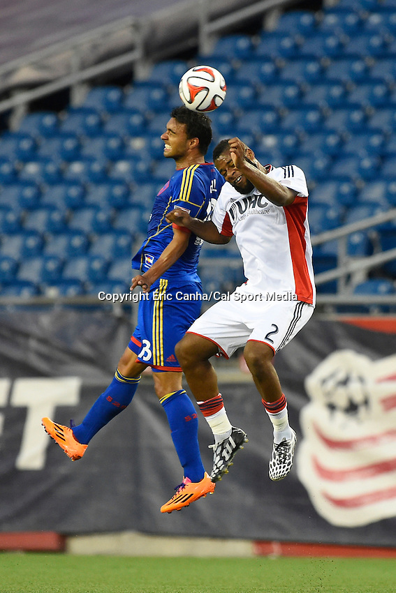 July 30, 2014 - Foxborough, Massachusetts, U.S. - Colorado Rapids' Kamani Hill (13) and New England Revolution's Andrew Farrell (2) fight to head the ball during the MLS game between the Colorado Rapids and the New England Revolution held at Gillette Stadium in Foxborough Massachusetts. The New England Revolution defeated the Colorado Rapids 3-0. Eric Canha/CSM