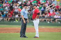 Kannapolis Intimidators manager Justin Jirschele (9) discusses a call with umpire Mark Stewart during the game against the Rome Braves at Kannapolis Intimidators Stadium on April 12, 2017 in Kannapolis, North Carolina.  The Braves defeated the Intimidators 4-3.  (Brian Westerholt/Four Seam Images)