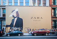 A billboard on a construction shed on Broadway in New York announces the imminent arrival of a Zara clothing store, seen on Saturday, September 19, 2015.  The chain is owned by Spanish retail giant Inditex. (© Richard B. Levine)