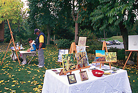 Artist's Display of Paintings at Cherry Point Vineyards, at the Cowichan Valley Wine & Culinary Festival, Vancouver Island, BC, British Columbia, Canada