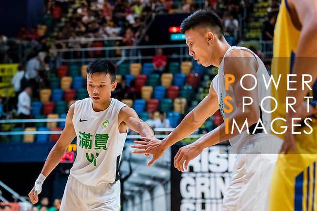 Au Yeung Wai Kong #41 of Tycoon Basketball Team reacts with Wong Yau Ti #15 of Tycoon Basketball Team (R) after shoots a free throw during the Hong Kong Basketball League playoff game between Tycoon and Winling at Queen Elizabeth Stadium on July 27, 2018 in Hong Kong. Photo by Yu Chun Christopher Wong / Power Sport Images