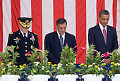 United States President Barack Obama attends a Memorial Day ceremony at Arlington National Cemetery in Arlington, Virginia. He is joined by Chairman of the Joint Chiefs Of Staff Martin Dempsey, left, and U.S. Secretary of Defense Defense Leon Panetta, center. .Credit: Kristoffer Tripplaar  / Pool via CNP