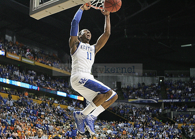 Freshman guard John Wall makes a dunk in the first half of UK's 74-45 win overTennessee at Bridgestone Arena in Nashville, TN during the SEC Semifinals on Saturday, March 13, 2010. Photo by Britney McIntosh | Staff
