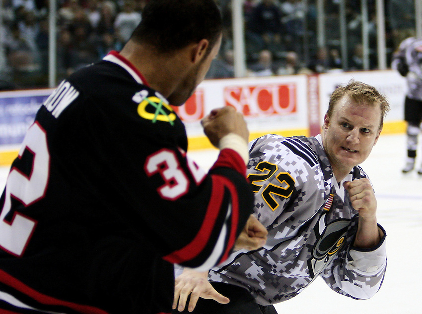 San Antonio Rampage right wing Francis Lessard, right, and Rockford IceHogs right wing Sean McMorrow fight during an AHL hockey game, Saturday, Feb. 28, 2009, at the AT&T Center in San Antonio, Texas. (Darren Abate/pressphotointl.com)