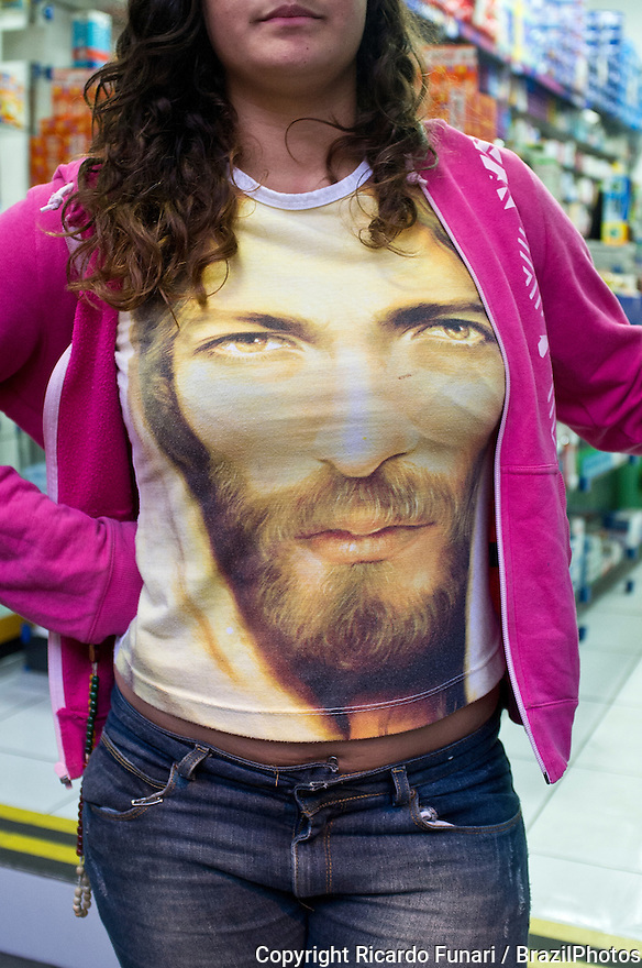 Young woman wears shirt painted with Jesus Christ face in a Catholic outdoor meeting for preparation for World Youth Day 2013 in Rio de Janeiro, Brazil.