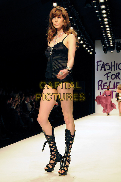 MODEL.The Fashion For Relief Haiti 2010 show for London Fashion Week Autumn/Winter 2010 at Somerset House, London, England..February 18th, 2010.LFW catwalk runway full length black ankle boots zip zipper open toe leotard .CAP/CAS.©Bob Cass/Capital Pictures.