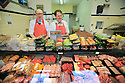TO GO WITH BREXIT STORY BY WWILLIAM WALLIS DATE: 31 Jan 2019 - William Collins (Right) with his brother John stand togeather in his butchers shop in Bessbrook, South Armagh, Northern Ireland. Photo/Paul McErlane