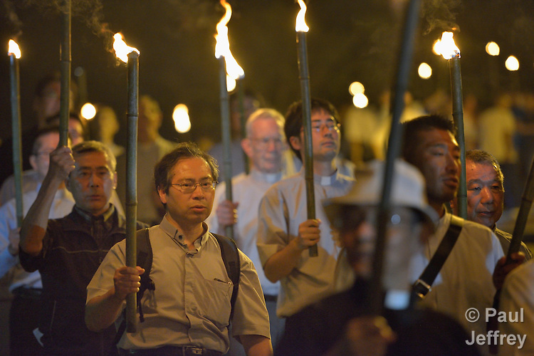 Priests participate in a torchlight march for peace in Nagasaki, Japan, on August 9, 2015, the 70th anniversary of the day the United States dropped an atomic bomb on the city. The procession began with a mass at the Urakami Cathedral--which was destroyed by the bombing and rebuilt years later.