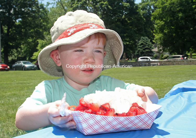 Southbury, CT-08 June 060814MK01 Three year old Nolan MacKrell scoops up his treat at the 38th annual Strawberry Festival sponsored by the United Church of Christ in Southbury Sunday afternoon, Donna Ryan, member of the board of directors said that approximately 9600 strawberries were sliced and prepared for the event. Michael Kabelka / Republican-American