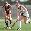 Liana McDonnell #16 of Garden City, right, gets pressured by Charlotte Howard #8 of Cold Spring Harbor during the Nassau County varsity field hockey Class B final at Adelphi University on Saturday, Oct. 28, 2017. McDonnell scored the lone goal of the game in the first half to lead Garden City to a 1-0 win.