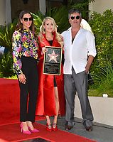 LOS ANGELES, CA. September 20, 2018: Carrie Underwood, Simon Cowell & Lauren Silverman at the Hollywood Walk of Fame Star Ceremony honoring singer Carrie Underwood.<br /> Pictures: Paul Smith/Featureflash