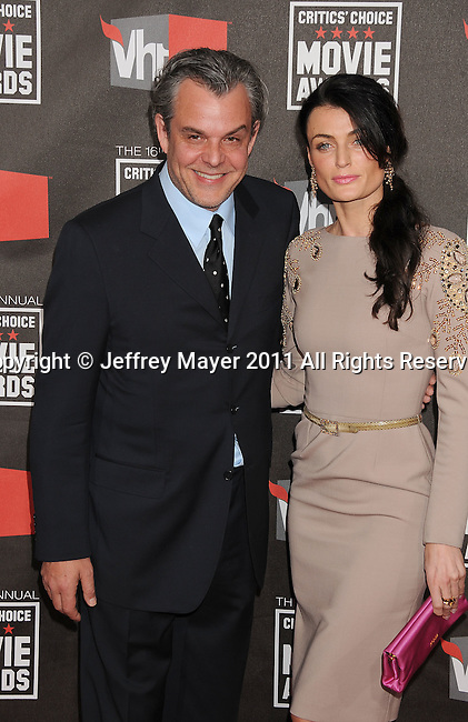 HOLLYWOOD, CA - January 14: Danny Huston and Lynn Renee arrive at the 16th Annual Critics' Choice Movie Awards at the Hollywood Palladium on January 14, 2011 in Hollywood, California.