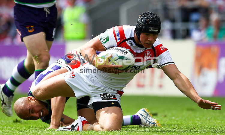 PICTURE BY ALEX WHITEHEAD/SWPIX.COM - Rugby League - Super League - St Helens vs Bradford Bulls - Langtree Park, St Helens, England - 09/06/13 - St Helens' Jonny Lomax is tackled by Bradford's Matty Blythe.