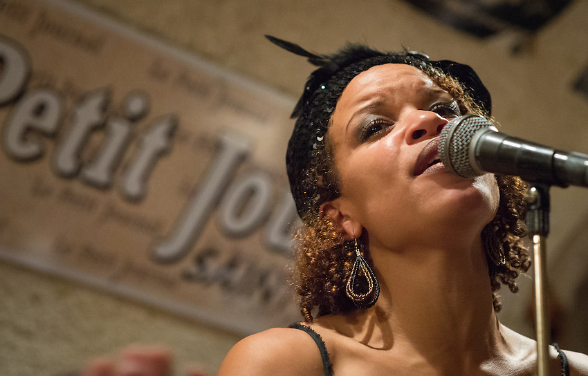 Nicolle Rochelle at a jazz concert by the Fantastic Harlem Drivers at the Petit Journal St Michel, Paris, Saturday 19th April 2014. The Fantastic Harlem Drivers consist of pianist Lou Lauprete, clarinetist Alain Marquet, double bass player Bernard Brimeur, and vocalists Sylvia Howard and Nicolle Rochelle, accompanied by tap-dancers Jelly Germain, his son Osiris Germain and Caroline Podetti. Lou Lauprete and Alain Marquet are regulars at Paris Boogie Speakeasy, the  private Parisian jazz club founded and run by Yves Riquet. Sylvia Howard sings with the Duke Ellington orchestra and the Black Label Swingtet, each led by saxophone player Christian Bonnet. Nicolle Rochelle is an internationally known singer, dancer, and actress, the star of Jerome Savary's 'Josephine' which ran for four years in France and Europe, in which Nicolle took the lead role as Josephine Baker. The evening was also attended by Yves Riquet (Sponsor and founder of Paris Boogie Speakeasy) and Jean-Paul Amouroux introduced as the finest player of Boogie-Woogie in Europe. The Fantastic Harlem Drivers were recently recorded for a new CD at Paris Boogie Speakeasy, 256 Rue Marcadet, Paris. Saturday 19th April 2014.