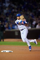 Chicago Cubs shortstop Addison Russell (27) throws to first base in the eighth inning during Game 4 of the Major League Baseball World Series against the Cleveland Indians on October 29, 2016 at Wrigley Field in Chicago, Illinois.  (Mike Janes/Four Seam Images)