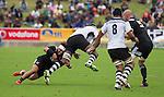 Ash Dixon tackles. Maori All Blacks vs. Fiji. Suva. July 11, 2015. Photo: Marc Weakley