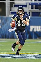 27 November 2010:  FIU quarterback Wesley Carroll (13) looks for an open receiver in the third quarter as the FIU Golden Panthers defeated the Arkansas State Red Wolves, 31-24, at FIU Stadium in Miami, Florida.