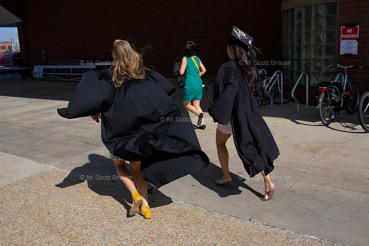 Graduating students rush to line up in the Rockwell Cage of the Johnson Athletics Center before the 2012 MIT Commencement on June 8, 2012, in Cambridge, Massachusetts, USA...Photo by M. Scott Brauer