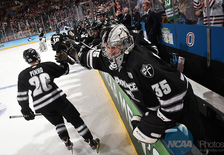 11 APR 2015: Shane Luke (20) of Providence College Friars celebrates after a first period goal against the Boston University Terriers during the Division I Men's Ice Hockey Championship held at the TD Garden in Boston, MA.  Providence defeated Boston 4-3 for the national title. Steve Babineau/NCAA Photos