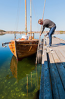 Harvesting oysters right at the dock of fisherman Per Karlsson's 19th-century boathouse Everts Sjöbod.