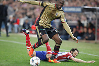 Atletico de Madrid´s Juanfran (R) and Milan´s Balotelli during 16th Champions League soccer match at Vicente Calderon stadium in Madrid, Spain. January 06, 2014. (ALTERPHOTOS/Victor Blanco)