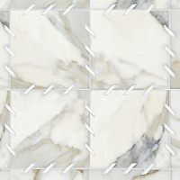 Ingrid, a stone water jet mosaic, shown in Calacatta Tia and Thassos, is part of the Ann Sacks Beau Monde collection sold exclusively at www.annsacks.com