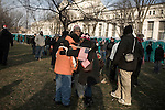 January 20, 2009. Washington, DC..Almost 2 million people packed the National Mall in sub freezing temperatures to witness the swearing in of Barack Obama, the 44th president of the united States and the first African American to hold the office. . People wrapped in blankets, coats and huddled together to try and keep warm in the hours leading up to the ceremonies.