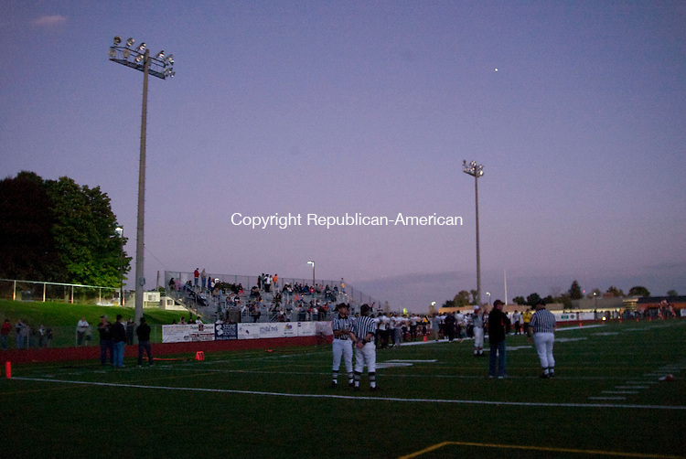 WATERTOWN, CT - 18 SEPTEMBER 2009 -091809JT08-<br /> Referees wait on the field after the power outage during Friday's game between Watertown and Kennedy at Watertown. The game was eventually canceled.<br /> Josalee Thrift Republican-American