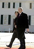 Mount Vernon, VA - February 19, 2007 -- United States President George W. Bush and first lady Laura Bush walk through Mount Vernon Estate as they attend celebration activities for George Washington's 275th birthday.<br /> Credit: Leslie E. Kossoff - Pool via CNP