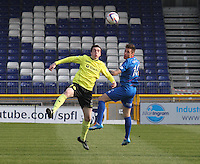 Sean Kelly (left) challenges Greg Tansey in the Inverness Caledonian Thistle v St Mirren Scottish Professional Football League Premiership match played at the Tulloch Caledonian Stadium, Inverness on 29.3.14.