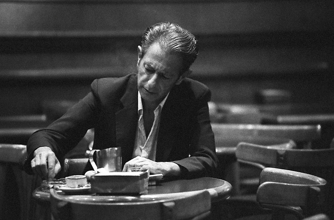 Buenos Aires Cafe, man putting out cigarette in coffee house