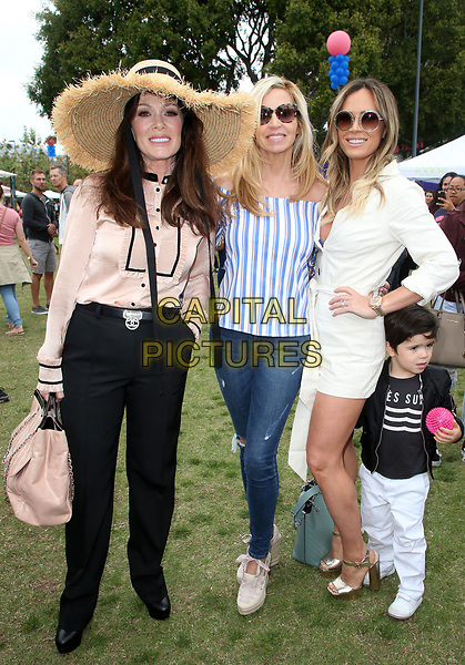 WEST HOLLYWOOD, CA - MAY 19: Lisa Vanderpump, Camille Grammer, Teddi Jo Mellencamp, at The Vanderpump Dog Foundation's 3rd Annual World Dog Day Event Presented by NexGard &amp; SUR Restaurant on May 19, 2018 at West Hollywood Park in West Hollywood, California on May 19, 2018. <br /> CAP/MPI/FS<br /> &copy;FS/MPI/Capital Pictures