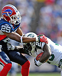 30 September 2007: Buffalo Bills cornerback Kiwaukee Thomas tackles New York Jets running back Leon Washington at Ralph Wilson Stadium in Orchard Park, NY. The Bills defeated the Jets 17-14 for their first win of the 2007 season...Mandatory Photo Credit: Ed Wolfstein Photo for UPI