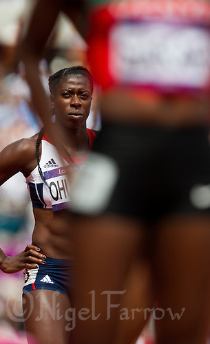 03 AUG 2012 - LONDON, GBR - Christine Ohuruogu (GBR) of Great Britain waits for the start of her women's 400m heat during the London 2012 Olympic Games athletics at the Olympic Stadium in the Olympic Park in Stratford, London, Great Britain .(PHOTO (C) 2012 NIGEL FARROW)