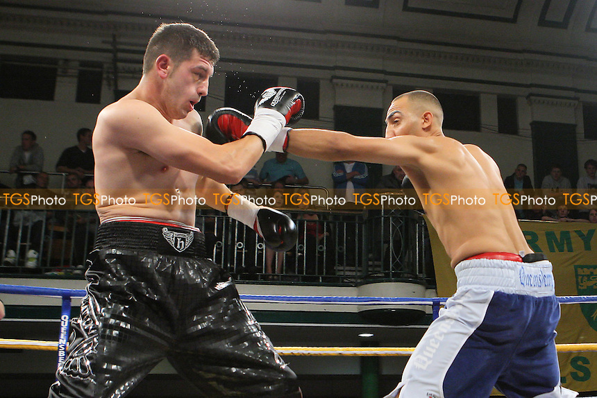 Bradley Skeete (blue shorts) defeats Steve Spence in a Welterweight boxing contest at York Hall, Bethnal Green, promoted by Frank Warren - 21/10/11 - MANDATORY CREDIT: Gavin Ellis/TGSPHOTO - Self billing applies where appropriate - 0845 094 6026 - contact@tgsphoto.co.uk - NO UNPAID USE