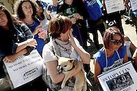 Roma 21 Giugno 2016<br /> Manifestazione degli Animalisti Italiani, vicino all'ambasciata della Cina, per protestare contro il Festival di Yulin che si terrà il 21 giugno. Yulin è una metropoli cinese di 5 milioni e mezzo di abitanti, dove il 21 giugno di ogni anno, per il solstizio d'estate, si celebra un Festival per il quale vengono macellati e poi mangiati circa 10mila cani.  Rappresentazione degli attivisti di Animalisti Italiani che hanno messo in scena quello che avviene nei giorni del Festival: cani e gatti torturati e bolliti vivi, dopo essere stati catturati per strada o sottratti ai loro padroni.<br /> Rome June 21, 2016<br /> Animal rights activists demonstrated, near the Embassy of China, to protest against the Festival of Yulin to be held on June 21. Yulin is a Chinese metropolis of 5 million and a half inhabitants, where on June 21 of each year, for the summer solstice, is celebrated a festival for which are then slaughtered and eaten about 10 thousand dogs.<br /> Representation Animal rights activists, who have staged what happens during the festival: dogs and cats tortured and boiled alive, after being captured in the street or taken from their masters.