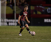 Mikey Ambrose (5) of Maryland passes the ball forward during the game at Ludwig Field on the campus of the University of Maryland in College Park, MD.  Maryland defeated Pittsburgh, 2-0.