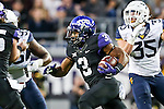 TCU Horned Frogs running back Shaun Nixon (3) in action during the game between the  West Virginia and the TCU Horned Frogs at the Amon G. Carter Stadium in Fort Worth, Texas.