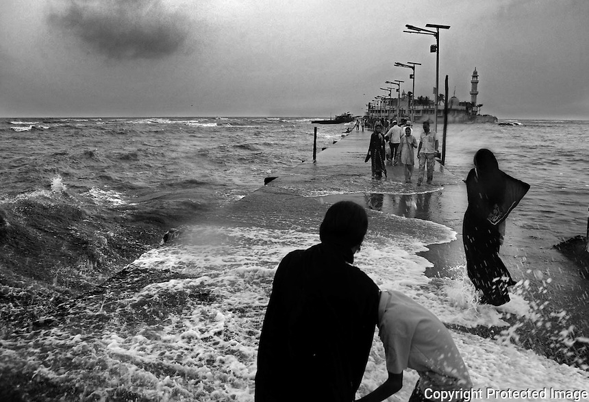 Devotees caught in Sudden Waves on the way to Haji Ali ,Mumbai - INDIA.